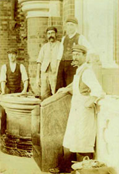 Workmen building the marble pulpit in 1904